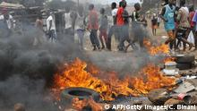 Tyres burn during clash between anti- riot policemen and Guinean opposition supporters on April 13, 2015 in Conakry. Several protesters were wounded on April 13 as Guinean police opened fire during violent demonstrations across the capital Conakry against the regime of President Alpha Conde. AFP PHOTO / CELLOU BINANI (Photo credit should read CELLOU BINANI/AFP/Getty Images)