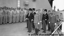 Japanese surrender signatories arrive aboard the USS MISSOURI in Tokyo Bay. Japanese Foreign Minister Mamoru Shigemitsu, in front with top hat, would sign the surrender. Sept. 2, 1945. World War 2. (BSLOC_2014_10_258) Keine Weitergabe an Drittverwerter.