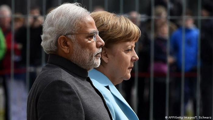German Chancellor Angela Merkel and Indian Prime Minister Narendra Modi inspect an honor guard before talks at the Chancellery in Berlin April 14, 2015 (Photo: TOBIAS SCHWARZ/AFP/Getty Images)