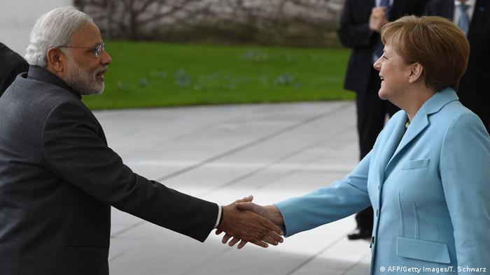 German Chancellor Angela Merkel and Indian Prime Minister Narendra Modi shake hands before talks at the Chancellery in Berlin April 14, 2015 (Photo: AFP PHOTO / TOBIAS SCHWARZ)