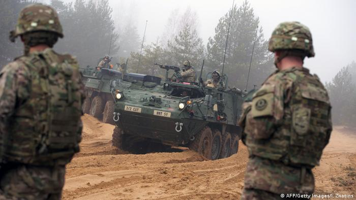 Picture taken on February 26, 2015 shows armored fighting vehicles IAV Stryker of the US Cavalry Regiment 2nd subdivision during training with Latvian an Canadian soldiers at the Adazi military training area in Latvia.