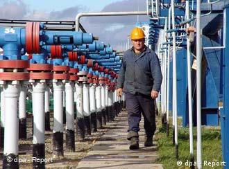 A man walks past a line of gas pipes