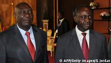 Central Africa's president Francois Bozize (R) stands next to Seleka rebel coalition chief Michel Djotodia (L) after talks in Libreville on January 11, 2013. Warring parties in the Central African Republic agreed Friday to call a ceasefire and form a government of national unity under President Francois Bozize, with elections planned in a year. A rebel coalition known as Seleka, or the 'Alliance,' took up arms in the lawless north of the impoverished country on December 10 and swept south, stopping within striking distance of the capital Bangui. AFP PHOTO / STEVE JORDAN (Photo credit should read Steve Jordan/AFP/Getty Images)