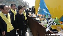 16.04.2015+++ South Korean President Park Geun-hye (3rd L) visits a port in Jindo during the first anniversary of the ferry disaster that killed more than 300 passengers, April 16, 2015. REUTERS/Yonhap ATTENTION EDITORS - NO SALES. NO ARCHIVES. FOR EDITORIAL USE ONLY. NOT FOR SALE FOR MARKETING OR ADVERTISING CAMPAIGNS. THIS IMAGE HAS BEEN SUPPLIED BY A THIRD PARTY. IT IS DISTRIBUTED, EXACTLY AS RECEIVED BY REUTERS, AS A SERVICE TO CLIENTS. SOUTH KOREA OUT. NO COMMERCIAL OR EDITORIAL SALES IN SOUTH KOREA