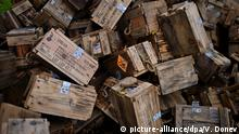epa04428097 Boxes for ammunition are piled in a yard in the village Gorni Lom, some 150 kilometers from Sofia, Bulgaria, 02 October 2014. Up to 15 people were missing and feared dead, with several others injured, after a blast in a Bulgarian explosives factory, officials said. Rescuers and investigators could not confirm the death toll until there is no longer a threat of further detonations, 24 hours after the initial explosion. At least three people outside the factory were injured. The plant had been producing explosives for civil use and dismaltling NATO ordnance. EPA/VASSIL DONEV +++(c) dpa - Bildfunk+++