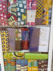 A display case showing numerous examples of genuine textiles