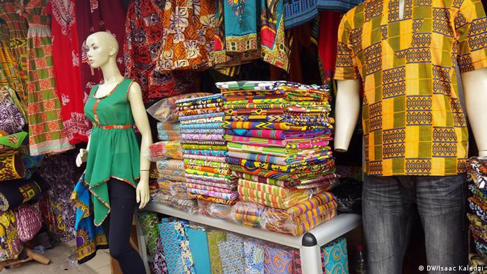 Original and fake textiles side by side at a shop in Accra