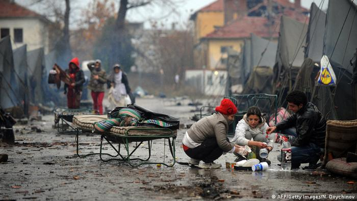 Syrian refugees in a dirty street in Bulgaria