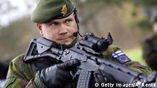 LEIPHEIM, GERMANY - NOVEMBER 21: A Finnish soldier patrols a military checkpoint on November 21, 2006 in Leipheim near Ulm, Germany. Germany, the Netherlands and Finland are working together to strengthen European rapid response capabilities, based on the EU (European Union) Battlegroups concept, by providing a fully operational, multinational military unit for the EU during the first half of 2007. (Photo by Andreas Rentz/Getty Images)