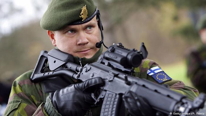 A Finnish soldier patrols a military checkpoint on November 21, 2006 in Leipheim near Ulm, Germany. Photo by Andreas Rentz/Getty Images