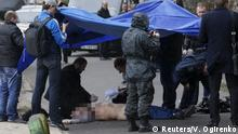 16.04.2015 * ATTENTION EDITORS - VISUAL COVERAGE OF SCENES OF INJURY OR DEATH Investigators work near the body of journalist Oles Buzina in Kiev April 16, 2015. A prominent Ukrainian journalist known for his pro-Russian views was shot dead on Thursday in Kiev by two masked gunmen, the interior ministry said, a day after a former lawmaker loyal to ousted President Viktor Yanukovich was also killed. Oles Buzina, 45, was known for his pro-Russian opinion pieces published in Ukraine's Sevodnya daily newspaper, which is part of the media empire of Ukraine's richest businessman Rinat Akhmetov. REUTERS/Valentyn Ogirenko TEMPLATE OUT TPX IMAGES OF THE DAY