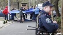 16.04.2015 * ATTENTION EDITORS - VISUAL COVERAGE OF SCENES OF INJURY OR DEATH Investigators work near the body of journalist Oles Buzina in Kiev April 16, 2015. A prominent Ukrainian journalist known for his pro-Russian views was shot dead on Thursday in Kiev by two masked gunmen, the interior ministry said, a day after a former lawmaker loyal to ousted President Viktor Yanukovich was also killed. Oles Buzina, 45, was known for his pro-Russian opinion pieces published in Ukraine's Sevodnya daily newspaper, which is part of the media empire of Ukraine's richest businessman Rinat Akhmetov. REUTERS/Valentyn Ogirenko TEMPLATE OUT