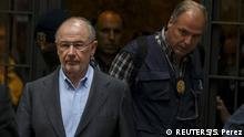 Rodrigo Rato (L), former People's Party minister and former managing director of the International Monetary Fund, is lead by police as they leave his residence after an inspection in Madrid, April 16, 2015. REUTERS/Sergio Perez