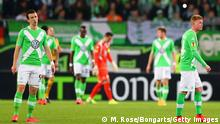 16.04.2015** WOLFSBURG, GERMANY - APRIL 16: Ivan Perisic (L) and Kevin De Bruyne of VfL Wolfsburg (R) look dejected as Marek Hamsík of Napoli scores the third goal during the UEFA Europa League Quarter Final first leg match between VfL Wolfsburg and SSC Napoli at Volkswagen Arena on April 16, 2015 in Wolfsburg, Germany. (Photo by Martin Rose/Bongarts/Getty Images)