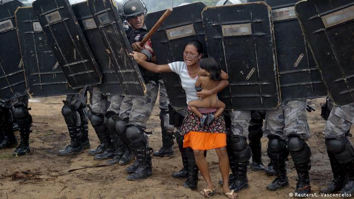 Indigenous people oppresed by police men