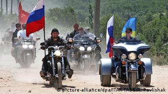 Moscow's Night Wolves motorbike club president Alexander Zaldostanov and Putin ride alongside each other