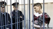 26.03.2015** Ukrainian military pilot Nadezhda Savchenko looks out from a defendants' cage as she attends a hearing at the Basmanny district court in Moscow March 26, 2015. Savchenko, 33, was captured by pro-Russian forces and handed over eight months ago to Russia, where she was imprisoned on charges of aiding the killing of two Russian journalists in east Ukraine. At home, she has become a symbol of resistance to Russian aggression. REUTERS/Maxim Shemetov TPX IMAGES OF THE DAY