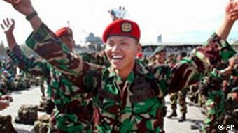 Indonesian Army soldiers sing and dance