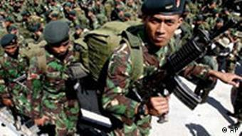 Indonesian Army soldiers board a navy ship