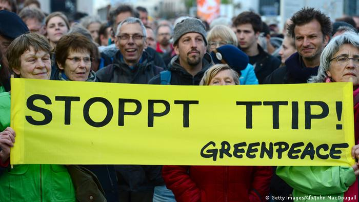 Greenpeace activists hold a banner reading Stop TTIP! as they protest against the proposed US-EU free trade pact or Transatlantic Trade and Investment Partnership in Berlin on April 18, 2015. AFP JOHN MACDOUGALL/AFP/Getty Images