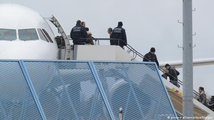 Rejected asylum seekers about to enter plane. Photo: Patrick Seeger/dpa