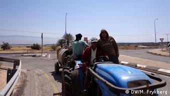 people on a tractor Copyright: Mel Frykberg