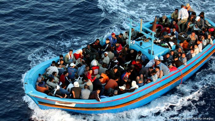 A boat carrying refugees across the sea
