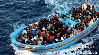 A boat loaded with illegal immigrant is seen on June 21, 2005 in Lampedusa, Italy (Photo: Marco Di Lauro/Getty Images)