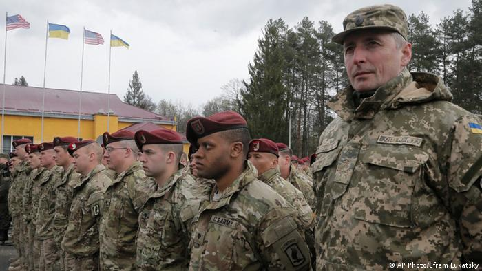 US and Ukrainian soldiers line up, during the opening ceremony of the 'Fearless Guardian - 2015', Ukrainian-US Peacekeeping and Security command and staff training, in the Lviv region, Western Ukraine, Monday, April 20, 2015.