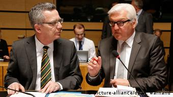 German Interior Minister Thomas de Maiziere (left) and German Foreign Minister Frank-Walter Steinmeier (right)