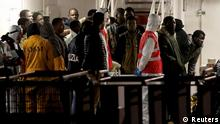 Surviving immigrants arrive by Italian coastguard ship Bruno Gregoretti in Catania's Harbour April 20, 2015. The European Union proposed doubling the size of its Mediterranean search and rescue operations on Monday, as the first bodies were brought ashore of some 900 people feared killed in the deadliest shipwreck while trying to reach Europe. REUTERS/Alessandro Bianchi