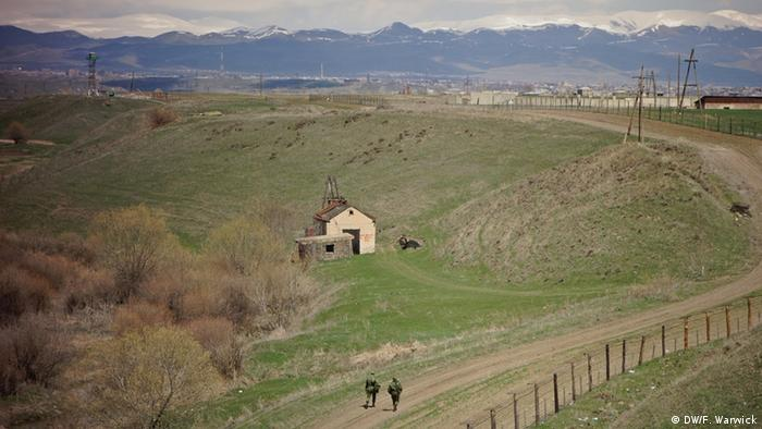 Two Russian soldiers patrol the border between Armenia and Turkey