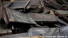 21.04.2015 * File photo of suitcases that belonged to people brought to Auschwitz for extermination, displayed at the former German Nazi concentration and extermination camp Auschwitz in Oswiecim January 19, 2015. A 93-year-old former bookkeeper at Auschwitz goes on trial in Germany April 21, 2015, accused by prosecutors of being an accessory in the murder of 300,000 people, even though he was not involved in any actual killing at the notorious Nazi death camp. The trial of Oskar Groening, who was 21 and by his own admission an enthusiastic Nazi when he was sent to Auschwitz in 1942, may turn out to be one of the last big Holocaust trials because so few Nazis suspected of committing crimes during World War Two are still alive. Groening's job at Auschwitz was to collect the belongings of deportees after they had arrived at the camp by train and had been put through a selection process that resulted in many being sent directly to the gas chambers. He was responsible for inspecting their luggage, removing and counting any bank notes that were inside, and ensuring they were sent on to SS offices in Berlin, where they helped to fund the Nazi war effort. REUTERS/Pawel Ulatowski