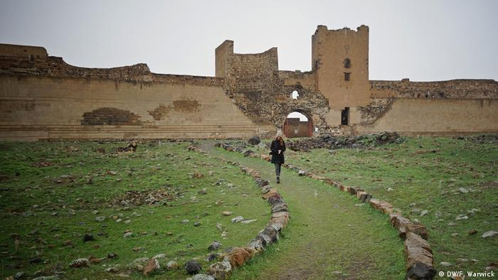A woman walks down the path that was once Ani's central road