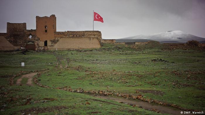 A Turkish flag flies from the walls of Ani