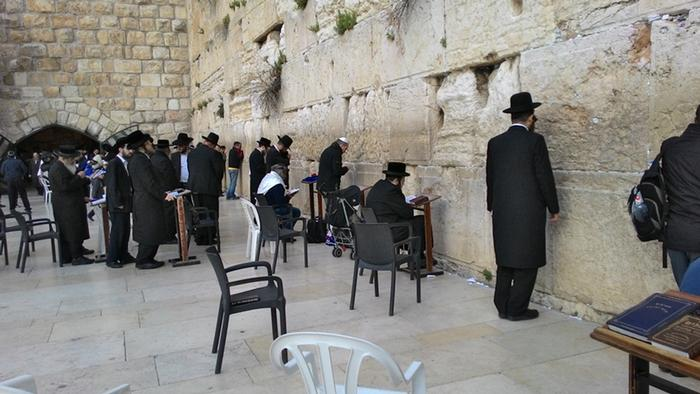 Men pray at the Western Wall
