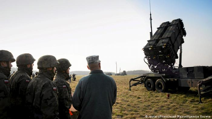 Polish and U.S. soldiers look at a Patriot missile defence battery during joint exercises at the military grounds in Sochaczew, near Warsaw, in this file picture taken March 21, 2015.