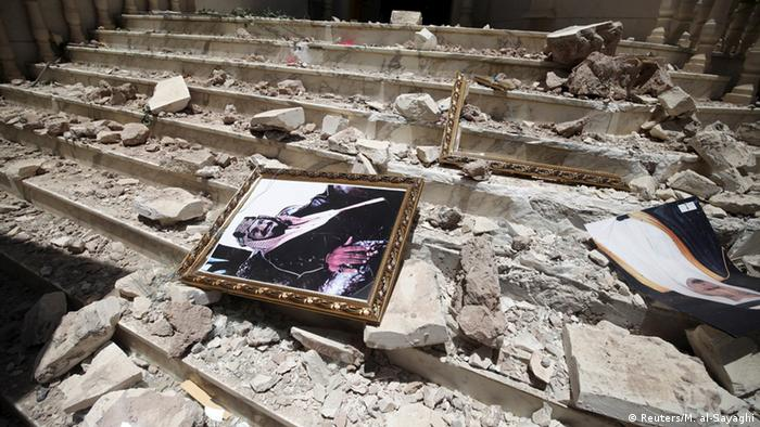 Picture of Saudi Arabia's King Salman bin Abdulaziz lies amid debris in Yemen