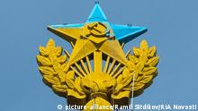 08/20/2014 The star on the spire of the Stalinist building at Kotelnicheskaya Embankment in Moscow has been painted blue by unidentified people. Earlier, a Ukrainian flag was hoisted on the spire. Ramil Sitdikov/RIA Novosti