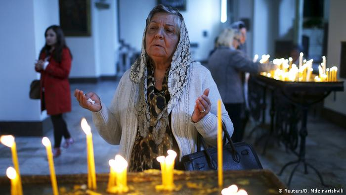 A woman prays in memory of the victims of mass killings of Armenians by Ottoman Turks at the Armenia's main cathedral in Echmiadzin, April 23, 2015