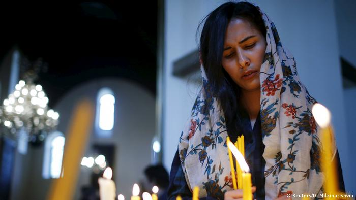 A woman prays in memory of the victims of mass killings of Armenians by Ottoman Turks at the Armenia's main cathedral in Echmiadzin, April 23, 2015.