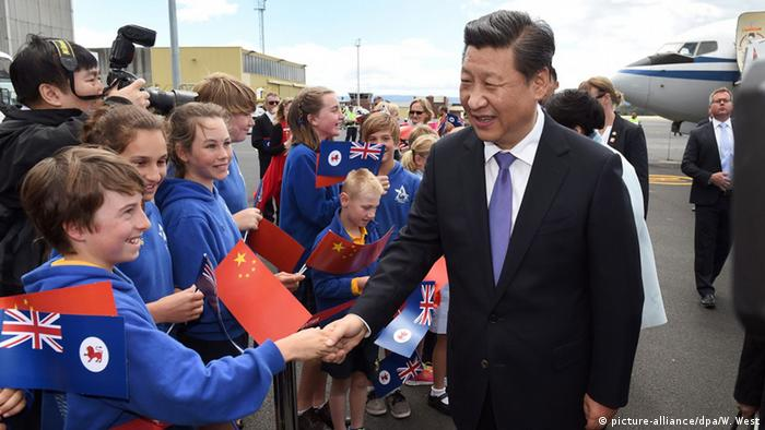 China's President Xi Jinping shakes hands with local schoolchildren as he arrives in Hobart, Australia, following the G20 leaders summit in Brisbane