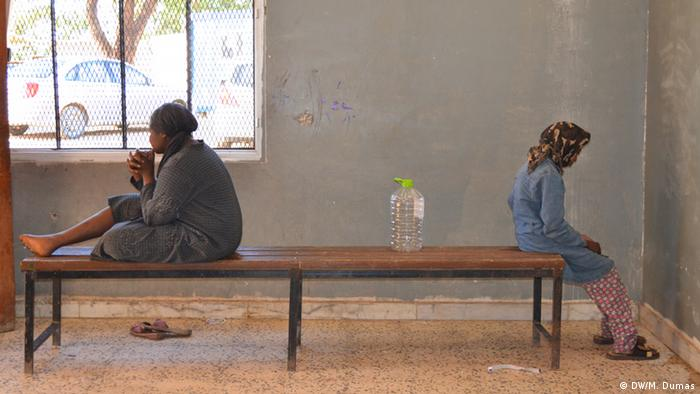 Children sit on top of table inside a Libyan detention camp.