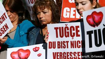 People holding banners reading Tugce,I hae not forgotten youREUTERS/Ralph Orlowski