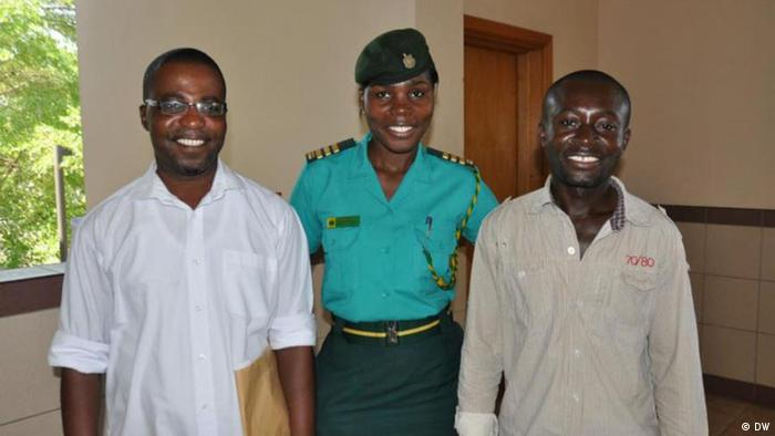 Eric Appiah and Eric Opoku Ware with an immigration officer