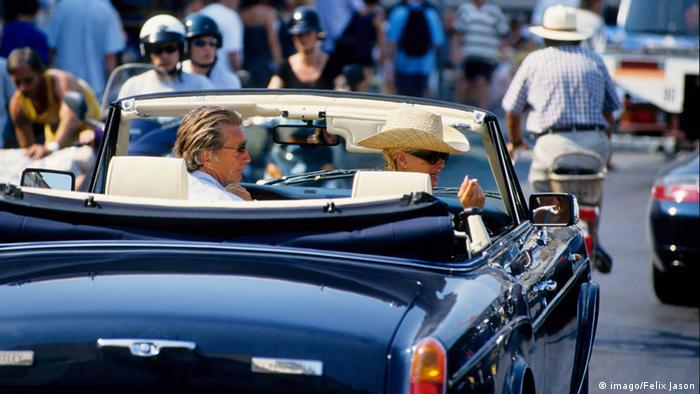 A man driving a Rolls-Royce