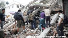 25.4.2015 *** epa04719898 People search for survivors in the rubble of a destroyed building after an earthquake hit Nepal, in Kathmandu, Nepal, 25 April 2015. A 7.9-magnitude earthquake rocked Nepal destroying buildings in Kathmandu and surrounding areas, with unconfirmed rumours of casualties. The epicentre was 80 kilometres north-west of Kathmandu, United States Geological Survey. Strong tremors were also felt in large areas of northern and eastern India and Bangladesh. EPA/NARENDRA SHRESTHA