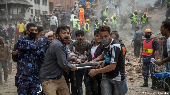 Emergency rescue workers carry a victim on a stretcher after Dharara tower collapsed on April 25, 2015 in Kathmandu, Nepal (Photo:Omar Havana/Getty Images)