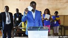 25.04.2015 Togo's President Faure Gnassingbe, candidate for his re-election,leaves a polling station after casting his vote for the presidential elections in Lome on April 25, 2015. Togo began voting for a new president, with the incumbent Faure Gnassingbe seeking a third term in office to extend his family's grip on power into a second half-century. AFP PHOTO / ISSOUF SANOGO (Photo credit should read ISSOUF SANOGO/AFP/Getty Images)