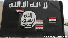 A wall painted with the black flag commonly used by Islamic State militants, near former Iraqi president Saddam Hussein's palace in Tikrit April 1, 2015. The Iraqi government claimed victory over Islamic State insurgents in Tikrit on Wednesday after a month-long battle for the city supported by Shi'ite militiamen and U.S.-led air strikes, saying that only small pockets of resistance remained. REUTERS/Thaier Al-Sudani